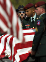 Bill Montag, center, watches as members of the honor guard deliver the casket of Montag's stepson, Eric O'Hara, at Fort Logan National Cemetery in Denver on Thursday afternoon.