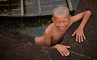 Boy at Angkor Wat playing in the water, Cambodia