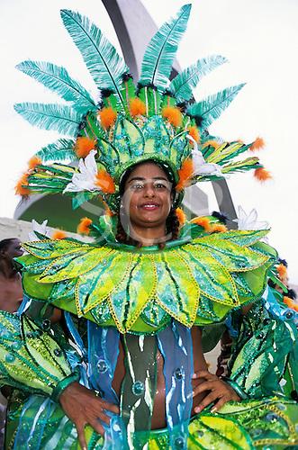 Rio de Janeiro, Brazil. Carnival; girl in brightly coloured opulent costume in green, blue, orange and yellow