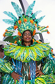 Rio de Janeiro, Brazil. Carnival; girl in brightly coloured opulent costume in green, blue, orange and yellow