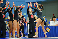 LOS ANGELES, CA - February 5, 2012:  Stanford's Rebecca Wing is congratulated by teammates during competition against the UCLA Bruins at the Wooden Center.   UCLA defeated Stanford, 197.250 - 196.450.