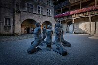 "Carl Bucher's ""The Petrified"" inside the ""Chateau de la Gruyère""'s courtyard"