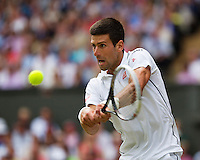July 6, 2014, UK, London, Tennis, Wimbledon, AELTC, Men's Singles Final:  Novak Djokovic (SRB) vs Roger Federer (SUI), Pictured: Novak Djokovic in action<br /> Photo: Tennisimages/Henk Koster