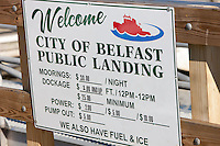 A welcome sign indicates services and fees for boaters at the public landing in Belfast, Maine.