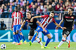 Yannick Ferreira Carrasco (c) of Atletico de Madrid competes for the ball with Julian Baumgartlinger (l) and Roberto Hilbert of Bayer 04 Leverkusen during their 2016-17 UEFA Champions League Round of 16 second leg match between Atletico de Madrid and Bayer 04 Leverkusen at the Estadio Vicente Calderon on 15 March 2017 in Madrid, Spain. Photo by Diego Gonzalez Souto / Power Sport Images