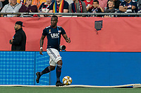 FOXBOROUGH, MA - SEPTEMBER 29: Cristian Penilla #70 of New England Revolution dribbles down the wing during a game between New York City FC and New England Revolution at Gillette Stadium on September 29, 2019 in Foxborough, Massachusetts.