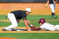 Shortstop Nick Natoli #12 of the Towson Tigers puts the tag on AJ Pettersen #1 of the Minnesota Golden Gophers as he tries to steal second base at Gene Hooks Field on February 26, 2011 in Winston-Salem, North Carolina.  The Gophers defeated the Tigers 6-4.  Photo by Brian Westerholt / Sports On Film