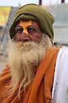 The yellow tilak painted on this gentleman's forehead shows he follows the Hindu God Vishnu.