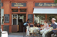 Wine bar and shop Au Bourguignon with outside seating and cyclists, Paris Paris, France.