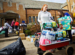 BELLE HARBOR, NEW YORK-NOVEMBER 01: Volunteers collect and distribute donations at Francis de Sales Church to residents of this Queens neighborhood after Hurricane Sandy November 1, 2012. Residents have set up a Facebook page Rockaway Relief to get assistance to their community.