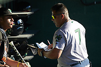 Augusta GreenJackets fundamentals coach Willie Romero (7) checks the lineup prior to the game against the Kannapolis Intimidators at Kannapolis Intimidators Stadium on June 21, 2019 in Kannapolis, North Carolina. The Intimidators defeated the GreenJackets 6-1. (Brian Westerholt/Four Seam Images)