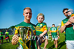 Gavin Crowley and his son Arlo after the Munster GAA Football Senior Championship Final match between Kerry and Cork at Fitzgerald Stadium in Killarney on Sunday.