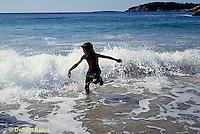 ON03-031z  Ocean - boy running in surf, waves breaking