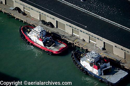 aerial photograph of tractor tug boats Resolute and Goliah docked at Pier 17, San Francisco, California