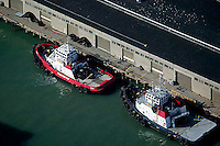 aerial photograph of tractor tug boats Resolute and Goliah docked at Pier 17, San Francisco, California
