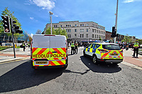 Pictured: Police attend while Palestinian and local people hold a rally in Swansea, Wales, UK. Sunday 16 May 2021<br /> Re: Palestinian people, joined by local supporters have held a rally against Israel, in the city centre of Swansea, Wales, UK.