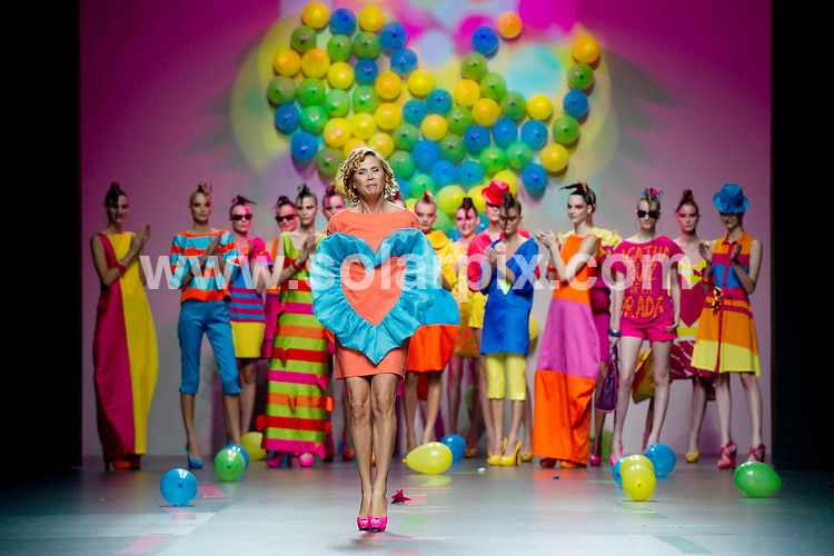 **ALL ROUND PICTURES FROM SOLARPIX.COM**                                             **WORLDWIDE SYNDICATION RIGHTS EXCEPT SPAIN - NO SYNDICATION IN SPAIN**                                                                                  .By the look of these pictures from Madrid Fashion Week, Spain is in for a far more colourful summer in 2012 than the UK with these bright colours contrasting with the beiges and browns from the London Fashion Week's offerings..Madrid. Spain. Cibeles Madrid Fashion Week. Agatha ruiz de La Prada Catwalk.                                                                           This pic:    Agatha ruiz de La Prada runway                                                                                          JOB REF:    13966    DMS dolores       DATE: 17.09.11                                                           **MUST CREDIT SOLARPIX.COM OR DOUBLE FEE WILL BE CHARGED**                                                                      **MUST AGREE FEE BEFORE ONLINE USAGE**                               **CALL US ON: +34 952 811 768 or LOW RATE FROM UK 0844 617 7637**