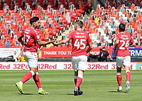 MaCauley Bonne, scorer of Charlton's second goal,  congratulates Alfie Doughty after scoring Charlton's first goal during Charlton Athletic vs Wigan Athletic, Sky Bet EFL Championship Football at The Valley on 18th July 2020