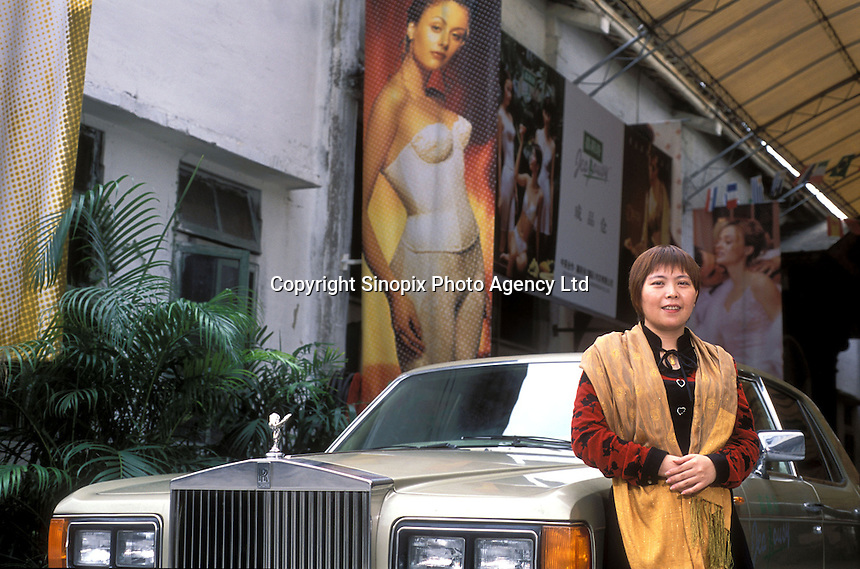 Manager of Jealousy underwear factory Luo Shun Xing, poses in front of her rolls Royce at Foshan, China. China. Jealousy is one of the largest underwear manufactures in International Underwear City producing more that 11 million pieces annually...PHOTO BY SINOPIX