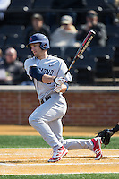 Michael Morman (8) of the Richmond Spiders follows through on his swing against the Wake Forest Demon Deacons at David F. Couch Ballpark on March 6, 2016 in Winston-Salem, North Carolina.  The Demon Deacons defeated the Spiders 17-4.  (Brian Westerholt/Four Seam Images)