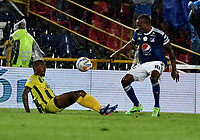 BOGOTA - COLOMBIA - 01 – 04 - 2018: Jair Palacios (Der.) jugador de Millonarios disputa el balón con Jefferson Torres (Izq.) jugador de Atletico Bucaramanga, durante partido de la fecha 12 entre Millonarios y por la Liga Aguila I 2018, jugado en el estadio Nemesio Camacho El Campin de la ciudad de Bogota. / Jair Palacios (R) player of Millonarios vies for the ball with Jefferson Torres (L) player of Atletico Bucaramanga, during a match of the 12th date between Millonarios and Atletico Bucaramanga, for the Liga Aguila I 2018 played at the Nemesio Camacho El Campin Stadium in Bogota city, Photo: VizzorImage / Luis Ramirez / Staff.