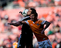 Eric Brunner (2) of the Houston Dynamo goes up for a header with Dwayne De Rosario (7) of D.C. United during a Major League Soccer game at RFK Stadium in Washington, DC. D.C. United vs. Houston Dynamo, 2-1.