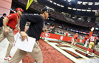 Feb 3, 2013; New Orleans, LA, USA; San Francisco 49ers head coach Jim Harbaugh takes the field before Super Bowl XLVII against the Baltimore Ravens at the Mercedes-Benz Superdome. Mandatory Credit: Mark J. Rebilas-