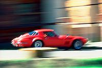Red Corvette race car in motion; racing; classic; vintage; automobiles, sportscar Red Corvette. Colorado, race track.