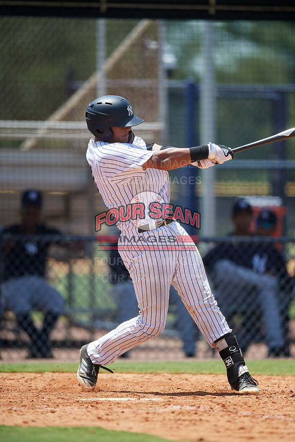 GCL Yankees West catcher Hemmanuel Rosario (21) follows through on a swing during a game against the GCL Yankees East on August 8, 2018 at Yankee Complex in Tampa, Florida.  GCL Yankees West defeated GCL Yankees East 8-4.  (Mike Janes/Four Seam Images)