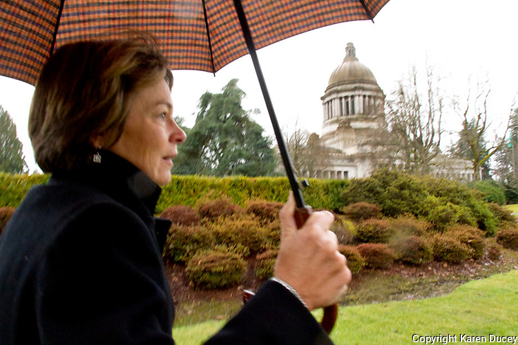"""Kathleen Conroy from Seattle, Wash., heads out to speak to her representatives at the state capitol during Humane Lobby Day in Olympia, Washington on January 28, 2013. Humane Lobby Day was organized by the ASPCA, HSUS, and Wolf Haven International to educate animal advocates """"learn and practice lobbying for animal protection laws at the state level"""". """"It is a full-day event including a lobbying workshop and an overview of relevant bills in your state legislature. Appointments are made for you with your state legislators so that you can meet with them (or their staff) face to face and ask for animal-friendly votes"""" according to the HSUS website."""