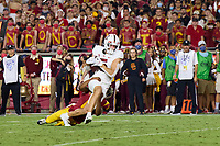 LOS ANGELES, CA - SEPTEMBER 11: John Humphreys #5 of the Stanford Cardinal is tackled by Isaac Taylor-Stuart #6 of the USC Trojans after a pass reception during a game between University of Southern California and Stanford Football at Los Angeles Memorial Coliseum on September 11, 2021 in Los Angeles, California.