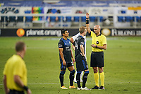 SAN JOSE, CA - OCTOBER 03: Referee Robert Sibiga gives a yellow card to Jackson Yueill #14 of the San Jose Earthquakes during a game between Los Angeles Galaxy and San Jose Earthquakes at Earthquakes Stadium on October 03, 2020 in San Jose, California.