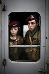 © Joel Goodman - 07973 332324 . 24/05/2014 . Heywood Station , Railway Street , Heywood, UK . L-R Nathan Lee (16 from Bolton ) and Matthew Marcantonatos (16 from Rochdale ) (both correct) , wearing British and Canadian airborne division uniforms , on the train . 1940s weekend on the East Lancs Railway , with visitors dressed up and partaking in 40s-themed events . Photo credit : Joel Goodman