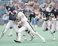 Toronto Argonauts defence Don Moen, Matthew Teague, Carl Brazley and Franklin King tackle Ottawa Rough Rider Dave Newman. Photo Scott Grant.