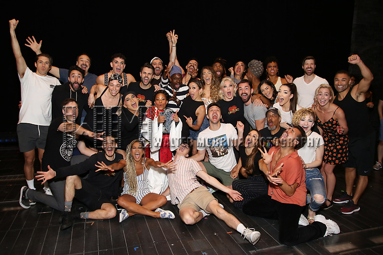 "Bahiyah Hibah, Aaron Tveit, Karen Olivo, Danny Burstein, Sahr Nguajah, Tam Mutu, Ricky Rojas and Robyn Hurder with cast during the Broadway Opening Night Legacy Robe Ceremony honoring Bahiyah Hibah for  ""Moulin Rouge! The Musical"" at the Al Hirschfeld Theatre on July 25,2019 in New York City."
