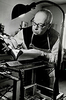 1983 FILE PHOTO - ARCHIVES -<br /> <br /> Work and prayer: Father Hilaire binds and repairs books.<br /> <br /> PHOTO :  Mike Slaughter  - Toronto Star Archives - AQP