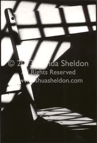 Shadows of window on chair back<br />