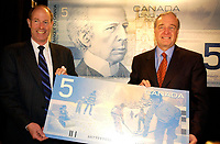 March 27. 2002, Montreal, Quebec, Canada; <br /> <br /> Paul Martin,Canada's Minister of Finance (and possible replacement to Liberal leaderJean Chretien) (R)<br />  and David Dodge, Governor of the Bank of Canada (L) <br /> unveil The second bank note in the new Canadian<br /> Journeyl, March 27th, 2002  in Montreal, Canada.<br /> <br /> Guests including Jean B»liveau, former NHL hockey player for the Montr»al Canadiens,<br />  Kim St. Pierre, member of the gold-medal-winning<br /> Canadian Olympic women's hockey team in Salt Lake City,<br />  and Myriam B»dard, Olympic gold medallist in the biathlon <br /> where attending the event that took place early this morning at the AMC Pepsi Forum Cinemas (build onside the former Forum hockey rink).<br /> <br /> The new $5 note will be available at financial institutions across Canada at approximately 10:30 a.m., on Wednesday, 27 March 2002<br />     <br /> <br /> <br /> NOTE :  D-1 H original JPEG, saved as Adobe 1998 RGB