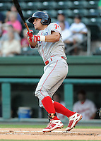 Catcher Sebastian Valle (9) of the Lakewood BlueClaws hits in a game against the Greenville Drive in Game 1 of the South Atlantic League Championship Series on Sept. 13, 2010, at Fluor Field at the West End in Greenville, S.C. Photo by: Tom Priddy/Four Seam Images