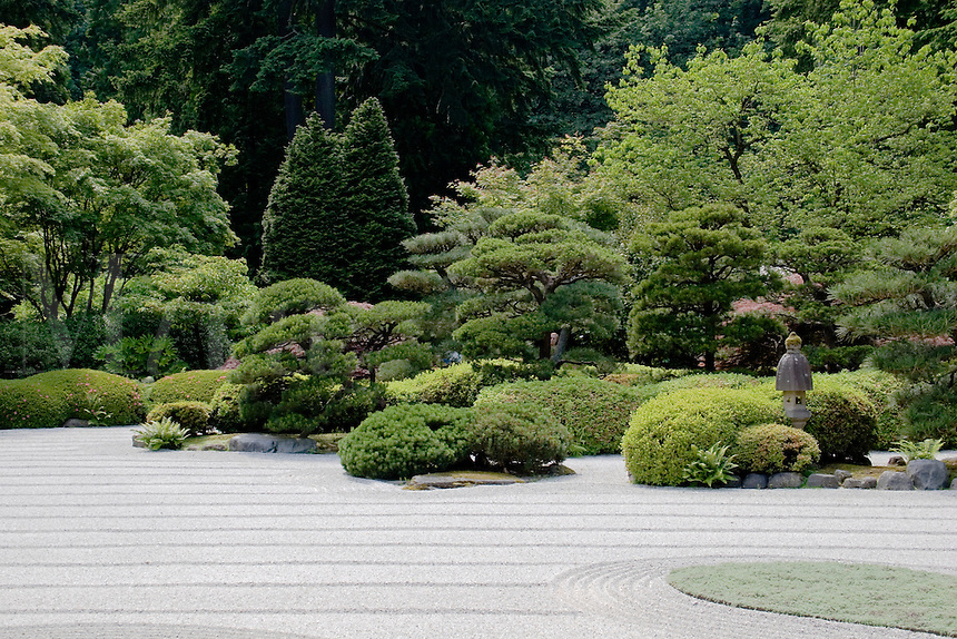 Raked sand and manicured trees & plants at the Portland Japanese garden, considered the most authentic outside of Japan - PORTLAND, OREGON.