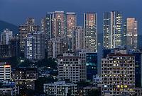 INDIA, Mumbai, illuminated windows of skyscraper in suburb Goregoan