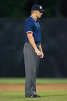 Brandon Hinson umpires the bases during an Appalachian League contest between the Elizabethton Twins and the Danville Braves at Dan Daniels Park in Danville, VA, Saturday, August 23, 2008. (Photo by Brian Westerholt / Four Seam Images)
