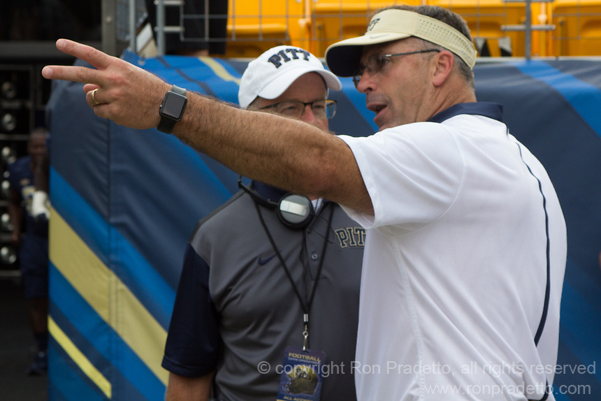 Pitt head coach Pat Narduzzi and radio sideline reporter Larry Richert talk at halftime. The Pitt Panthers football team defeated the Youngstown State Penguins 45-37 on Saturday, September 5, 2015 at Heinz Field, Pittsburgh, Pennsylvania.