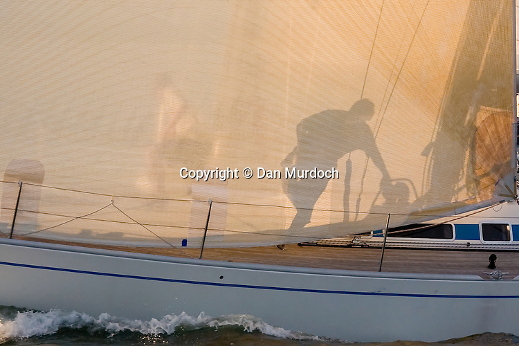 shadow of crew on sailboat