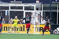 FOXBOROUGH, MA - JULY 25: Bjorn Johnsen #9 of CF Montreal leaps to take a shot at goal during a game between CF Montreal and New England Revolution at Gillette Stadium on July 25, 2021 in Foxborough, Massachusetts.