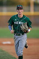 Venice Indians outfielder Michael Robertson (12) jogs to the dugout during a game against the Braden River Pirates on February 25, 2021 at Braden River High School in Bradenton, Florida.  (Mike Janes/Four Seam Images)