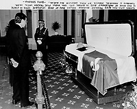 Quebec Premier Robert Bourassa beside former Premier Rene Levesque, lying (?) in state, November 4, 1987 at the red room of the nation assembly in Quebec City.<br /> <br /> Funeral beeing held the enxt day ; Nov 5 1987<br /> <br /> Photo : Boris Spremo - Toronto Star archives - AQP
