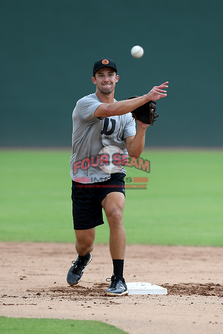 Eli White of the Texas Rangers works an infield drill with other Major League and Minor League players from around the region on Friday, June 5, 2020, at Fluor Field at the West End in Greenville, South Carolina, as team workouts remain shut down. White was drafted out of Clemson. (Tom Priddy/Four Seam Images)