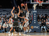 WASHINGTON, DC - FEBRUARY 19: Qudus Wahab #34 of Georgetown defends on a shot from Nate Watson #0 of Providence during a game between Providence and Georgetown at Capital One Arena on February 19, 2020 in Washington, DC.