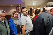 Worried residents of West Kensington and Gibbs Green Estates queue at a consultation meeting called by Hammersmith and Fulham about proposals to sell the estates to a private developer and demolish them.  Council officers refused to address the residents as a group, and most were turned away without being given any further information.